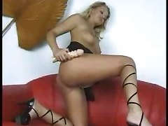 Sexy Blonde Amuses With Her Red Pussy