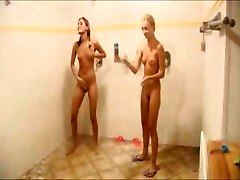 Little teen girls playing in the shower