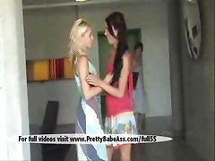 Two sexy girls kissing in public