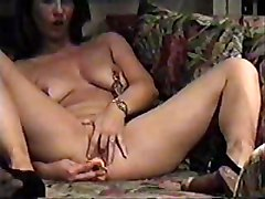 Hidden Cam In Livingroom. My Mom Clamps On Nipples Masturbating