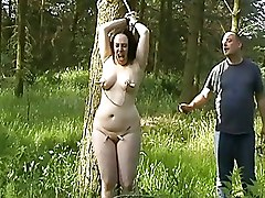 Amateur BDSM BDSM English Amateur Slave Tied To A Tree Tortured outdoor bdsm tit torture