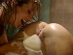 Two Hot Lesbians Playing With Dildo And Squirting