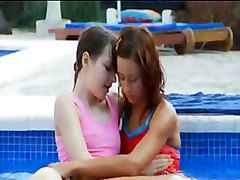 sweet lesbian girlfriends making love the pool