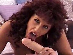 Redhead Sucking A Dildo