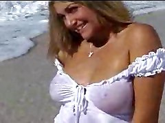 Busty Blonde Babe On Beach