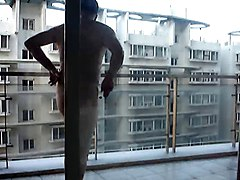 Nudist On Balcony In Public
