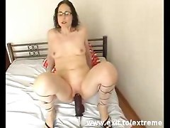 This is bizarre  this is super extreme  A german mother inserts a huge dildo deep in her pussy