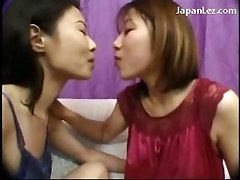 2 Asian Girls In Nighty Kissing Spitting On The Couch