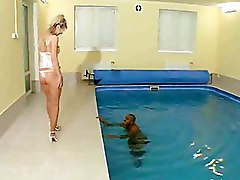 Blonde Woman Squats Down To Suck Cock Near Pool