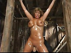 oiled bdsm fetish bondage whipping