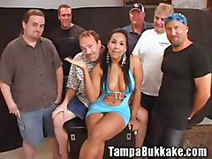 Busty latina on bukkake gangbang party
