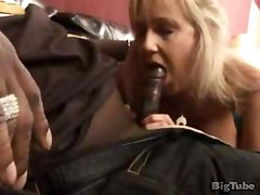 a milf gives a thug a blow job on a couch