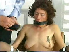 Police officer puts clamps on pussy lips of horny prisoner and elektroshocks them