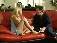 Housewife fucked on red leather couch