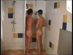 Mom and son having fun in shower