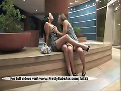 Two beautiful girls kissing in public