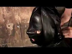 Girl Bondaged To Black Cloths Blindfolded Getting Her Tits Whipped In The Dungeon