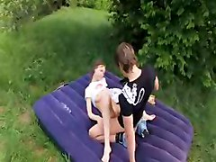 Curly chick sucks the head of a dick outdoor