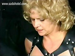 Slave With Big Hangin Tits And Large Nipples Is Covered With Hot Candle Wax And Is Spanked On Her Ass In A Dungeon
