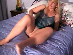 blonde milf mature vibrator bed masturbation solo lingerie pantyhose sextoys