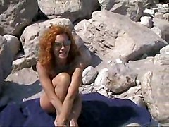 Hot Redhead On Sunny Beach
